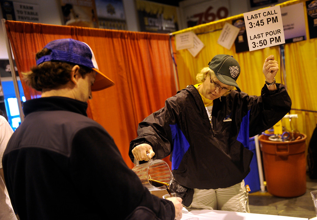 . DENVER, CO. - OCTOBER 12: Darcie Matson poured one of the last tastes of the afternoon session of the Great American Beer Festival Saturday afternoon. The was pouring selections available from the Loop Brewing Company of McCook, Nebraska. Thousands of beer fans flocked to the Great American Beer Festival at the Colorado Convention Center Saturday afternoon, October 12, 2013. Photo By Karl Gehring/The Denver Post