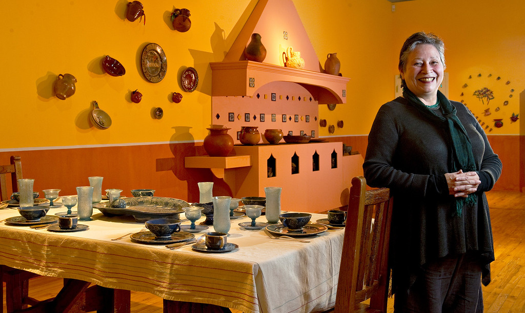 """. Museo de las Americas executive director Maruca Salazar \""""in the kitchen\"""" at the new exhibit \""""La Cocina\"""" at the museum on Friday, October 11, 2013.  The exhibit opens October 17th.   (Photo By Cyrus McCrimmon/ The Denver Post )"""