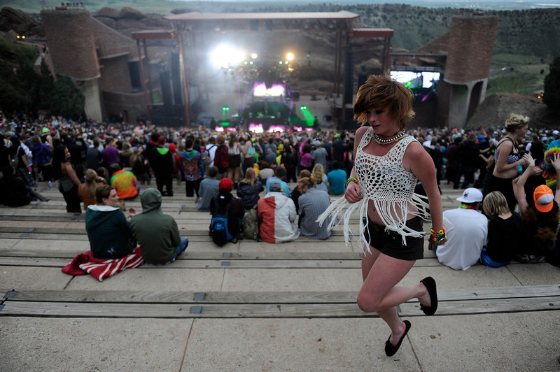 . Emily Spaulding, 17, of Aurora, Colorado dances as Dotexe performs during the Global Dub Festival at Red Rocks Amphitheatre on May 16, 2014 in Morrison, Colorado. (Photo by Seth McConnell/The Denver Post)