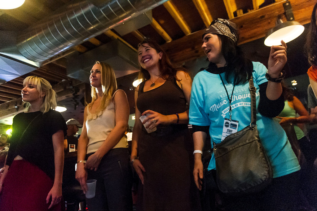 . People, including Leah Haverhals, (2nd from Right, brown top) sway to the music of Donny D Rose at Gary Lee\'s Motor Club and Grub along South Broadway during the Annual Underground Music Showcase on Friday, July 25, 2014 in Denver, Colorado.    (Photo by Kent Nishimura/The Denver Post)