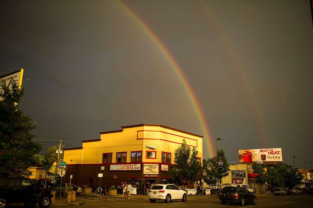 . A double rainbow forms a backdrop to the Skylark Lounge along South Broadway during the Annual Underground Music Showcase on Friday, July 25, 2014 in Denver, Colorado.    (Photo by Kent Nishimura/The Denver Post)
