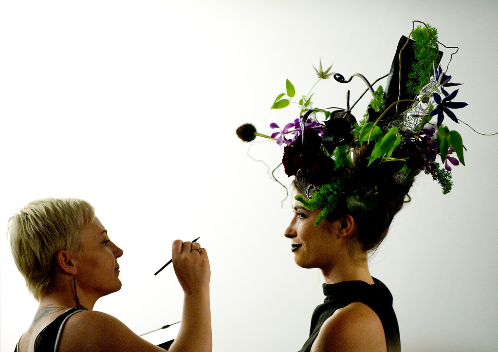 . DENVER, CO - SEPTEMBER 6:  Jamie Dowling, left, does the makeup of model Rebecca Artzer, who was wearing an Arthur Williams floral head piece backstage at the Fashion Group International of Denver\'s Rising Star 2013 fashion show on Friday September 6, 2013  at the McNichols Building in Denver. (Photo By Cyrus McCrimmon/The Denver Post )