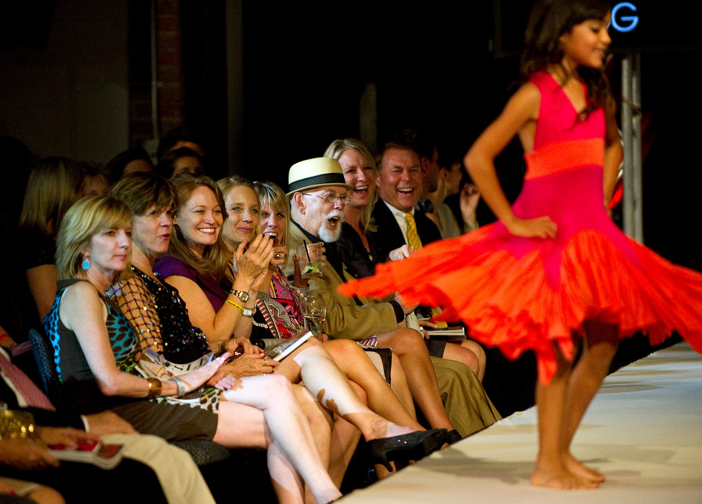 . DENVER, CO - SEPTEMBER 6:   The  clothes of Vicki Sigg\'s Pixie Girl  get a big cheer. Sigg was a finalist at the Fashion Group International of Denver\'s Rising Star 2013 fashion show on Friday September 6, 2013  at the McNichols Building in Denver. (Photo By Cyrus McCrimmon/The Denver Post )