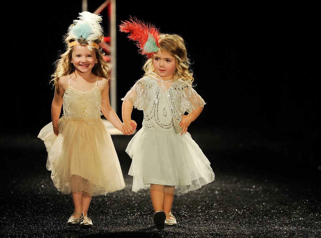 . DENVER, CO - OCTOBER 18 :   Two models wears Little Me\'s  attire at the Celebrate Fashion in Cherry Creek North  Show. It  was held at the JW Marriott  Denver on Friday, October 18, 2013.   (Photo By Cyrus McCrimmon/ The Denver Post )