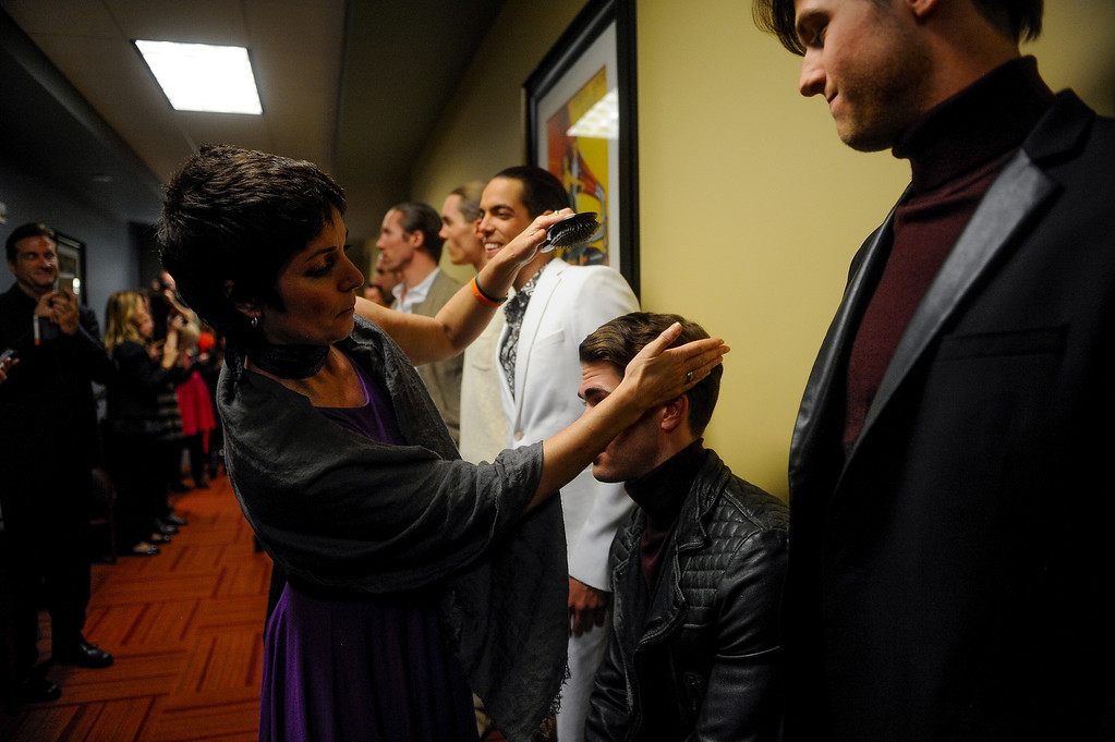. Dominique Rohde makes last minute touches to a model\'s hair before the start of the fashion show for the American Crew man\'s debut of their 2014 collection: The Independent. The show also featured the announcement of the U.S. and Canadian winners of the American Crew All-Star Challenge. (Photo By Erin Hull/The Denver Post)