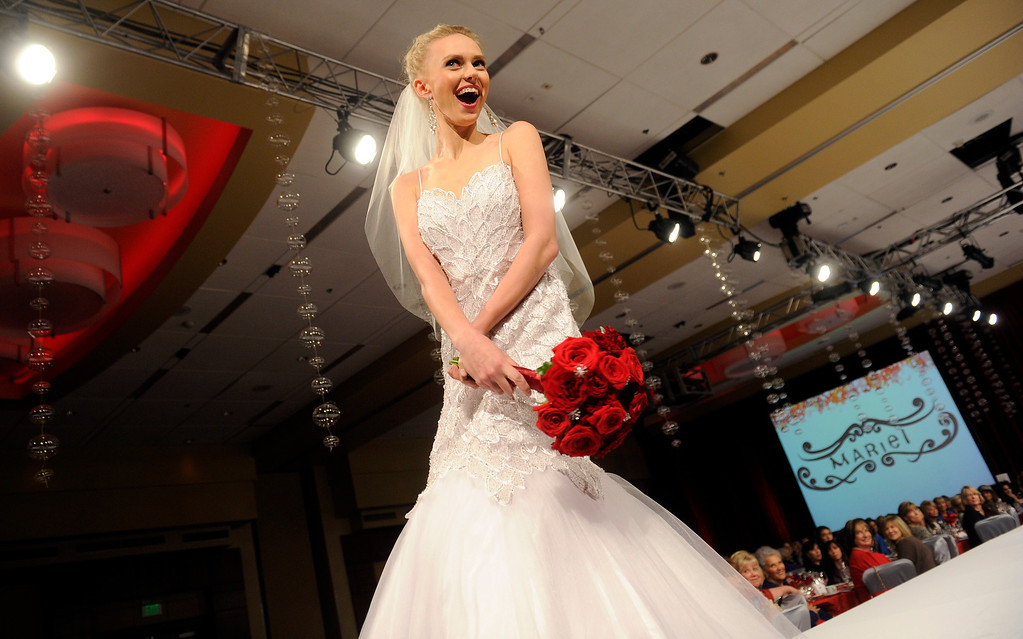 . The bridal gown at the  Brass Ring Fashion Show on Tuesday, November 19, 2013 at the Marriott City Center. The proceeds of this event will benefit The Guild of the Children�s Diabetes Foundation at Denver, and support the programs of The Guild including Helping Hand (families in need assistance program), Scholarship Program for young people with diabetes, Diabetes Awareness and Education Program and the Barbara Davis Center clinic and research programs. The Fashion Show featured Mariel�s Holiday Collection and a special presentation of evening wear by Alberto Makali. Photo By Cyrus McCrimmon/The Denver Post)