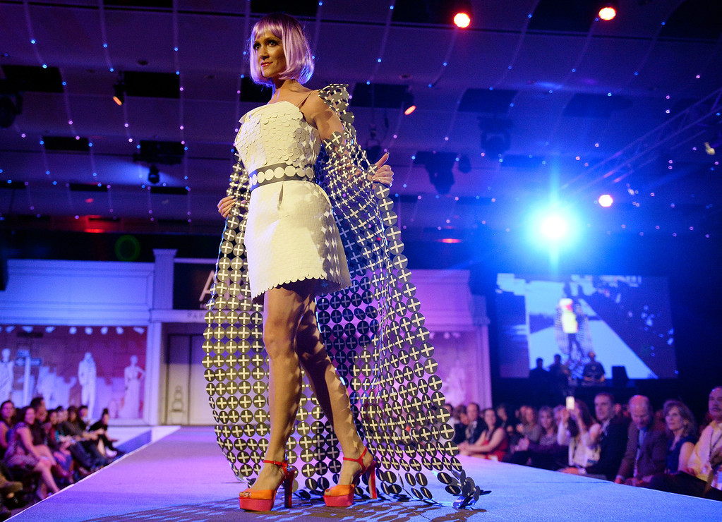 """. DENVER, CO - MARCH 7 : \""""Seeing Spots\""""  modeled by Brooke Huebner at  the 10th annual  ADCD Paper Fashion Show was held at the Seawell Grand  Ballroom at the Denver Center for Performing Arts on Friday, March 7, 2014. (Denver Post Photo by Cyrus McCrimmon)"""