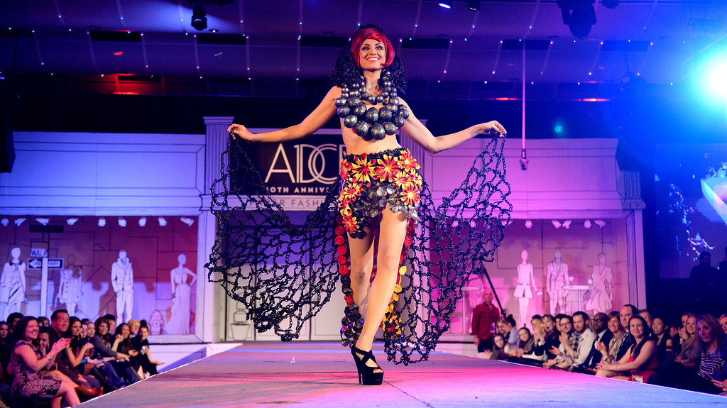 """. DENVER, CO - MARCH 7 :  Dava Favorite winner of the evening \""""A-Bomb\"""" by Pink Shag Design is modeled by Athena Patacsil at the 10th annual  ADCD Paper Fashion Show which  was held at the Seawell Grand  Ballroom at the Denver Center for Performing Arts on Friday, March 7, 2014. (Denver Post Photo by Cyrus McCrimmon)"""