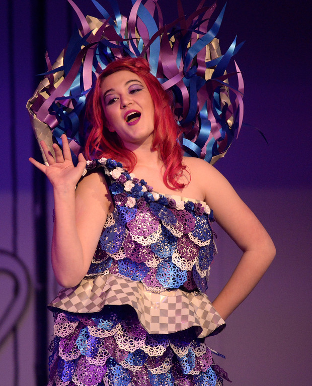 """. DENVER, CO - MARCH 7 :  Payton Deroin models the \""""Under A Purple Moon\"""" design at  the 10th annual  Art Directors Club of Denver Paper Fashion Show was held at the Seawell Grand  Ballroom at the Denver Center for Performing Arts on Friday, March 7, 2014. (Denver Post Photo by Cyrus McCrimmon)"""