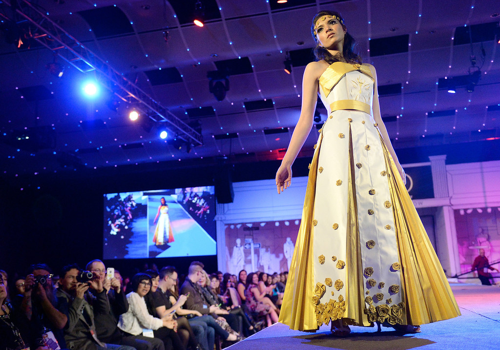 """. DENVER, CO - MARCH 7 :   Inda Kalvoda models \""""Gold Dust\""""  by Kalivoda at OTIS at the 10th annual  ADCD Paper Fashion Show which  was held at the Seawell Grand  Ballroom at the Denver Center for Performing Arts on Friday, March 7, 2014. (Denver Post Photo by Cyrus McCrimmon)"""