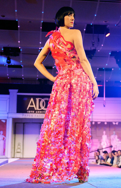 """. DENVER, CO - MARCH 7 :  The \""""Red Lotus\"""" design  modeled by Elle Ullom  at  the 10th annual  ADCD Paper Fashion Show which  was held at the Seawell Grand  Ballroom at the Denver Center for Performing Arts on Friday, March 7, 2014. (Denver Post Photo by Cyrus McCrimmon)"""