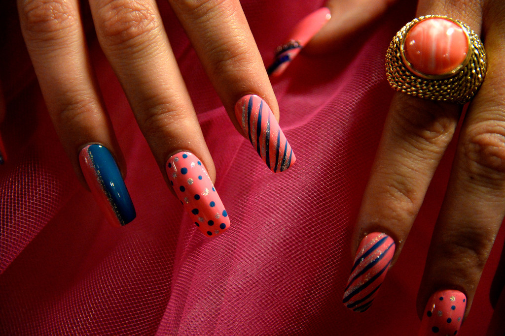 . Tesha Olson shows off her nails backstage during the Colorado Hairstylist Awards. Denver Fashion Weekend at the City Hall Amphitheater on Sunday, April 6, 2014. (Photo by AAron Ontiveroz/The Denver Post)