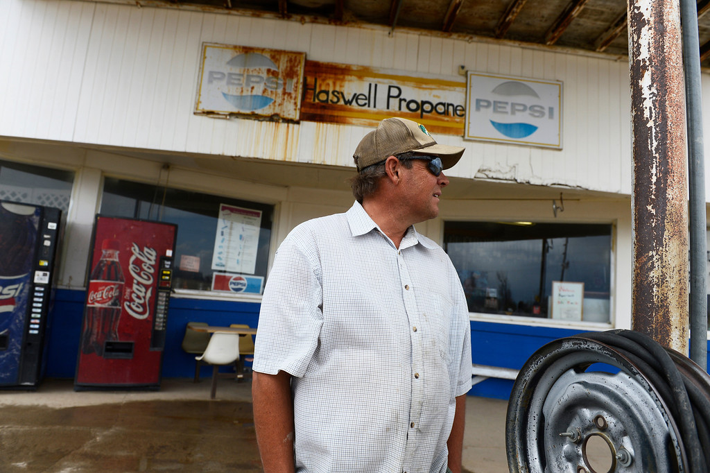 . HASWELL, CO - MAY 29:  Paul Stoker, stands outside of his store, the Haswell Propane and Fuel company in Haswell Colorado, Wednesday May 29, 2013. Stoker\'s family business serves multiple purposes including propane and gasoline sales, but also as the town gathering place. (Photo By Andy Cross/The Denver Post)