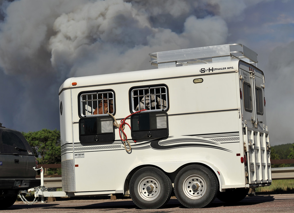 . Colorado Springs, CO. - June 11: Evacuees are leaving the smoke covered BLack Forest area. Colorado Springs, Colorado. June 11, 2013. The fire is about 15 acres near the 12600 block of Peregrine Way near Black Forest Regional Park. (Photo By Hyoung Chang/The Denver Post)