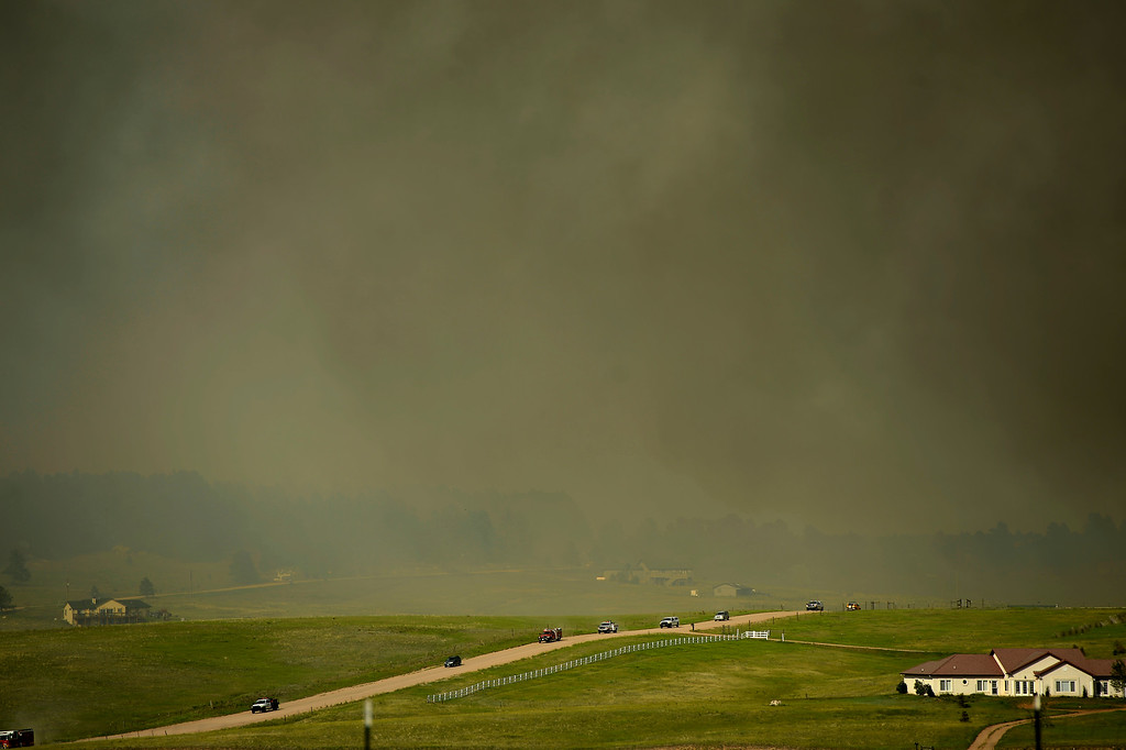 . COLORADO SPRINGS, CO. - June 12: Residents and emergency personal evacuating as the Black Forest Fire moves towards Walker Road. Colorado Springs, Colorado. June 12, 2013 Denver, Colorado Springs. (Photo By Joe Amon/The Denver Post)