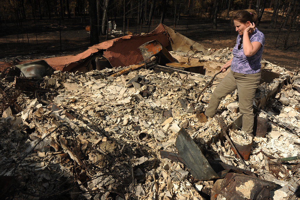 . BLACK FOREST, CO - JUNE 18:  Amy Feik sifts through the rubble of what was the home she shared with boyfriend Robert Runyard in Black Forest, Co on June 18, 2013.  Feik and Robert Runyard, not pictured, returned home for the first time to their home on Swan Road in Black Forest, CO on June 17, 2013.  Residents of Black Forest were finally allowed back into their burned homes for the first time since the fire devoured thousands of acres inside the Black Forest taking with it 502 homes and two lives.  Photo by Helen H. Richardson/The Denver Post)
