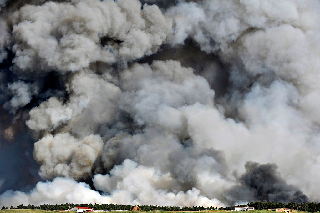 . A wall of smoke looms large over the horizon as the Black Forest fire destroys the landscape south of Mountain Dance Drive and Open Sky Way, which is northeast of Colorado Springs, on June 11, 2013. The Black Forest fire started around 1:45pm that day.