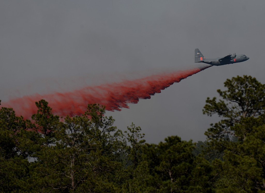. COLORADO SPRINGS, CO. - June 12:  A slurry bomber fights the Black Forest Fire. Colorado Springs, Colorado. June 12, 2013. According to El Paso County Sheriff Terry Maketa, the Black Forest Fire north of Colorado Springs has already burned 80 to 100 homes. (Photo By Hyoung Chang/The Denver Post)