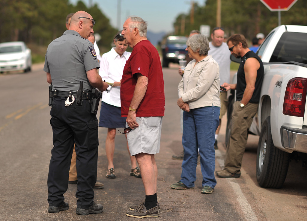 . Walt Hessler, front right, and evacuees of Black Forest fire are waiting El Paso County Sheriff\'s escort to their property at the corner of Vollmer Rd. and Burgess Rd. Colorado Springs, Colorado. June 14, 2013.  (Photo By Hyoung Chang/The Denver Post)
