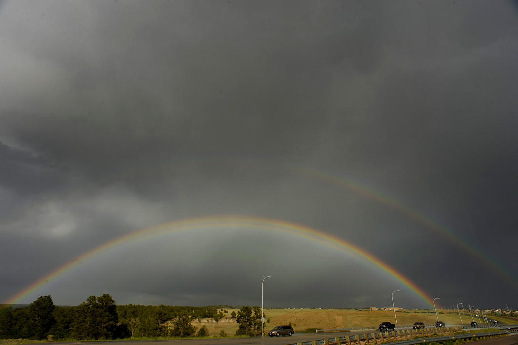 . BLACK FOREST, CO - JUNE 17:   A double rainbow sits over the Black Forest Fire burn area while Colorado Springs residents turn out each and every night with signs and flags to cheer on the firefighters as they come off the line for the night from fighting the Black Forest Fire in Black Forest on June 17, 2013.  Photo by Helen H. Richardson/The Denver Post)