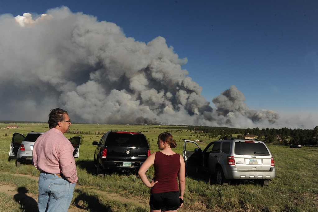. COLORADO SPRINGS, CO - JUNE 11: Homeowners watch the fire from a high meadow north of the fire. A wild land fire started around 2:00 in the Black Forest northeast of Colorado Springs, CO on June 11, 2013.  Homes have already burned and the wind is expected to continue through the afternoon.  Photo by Helen H. Richardson/The Denver Post)