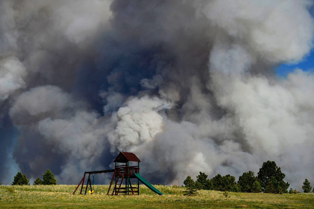 . COLORADO SPRINGS, CO - JUNE 11: Playground equipment sits in an evacuated neighborhood as the Black Forest fire burns east of Colorado Springs. (Photo by AAron Ontiveroz/The Denver Post)