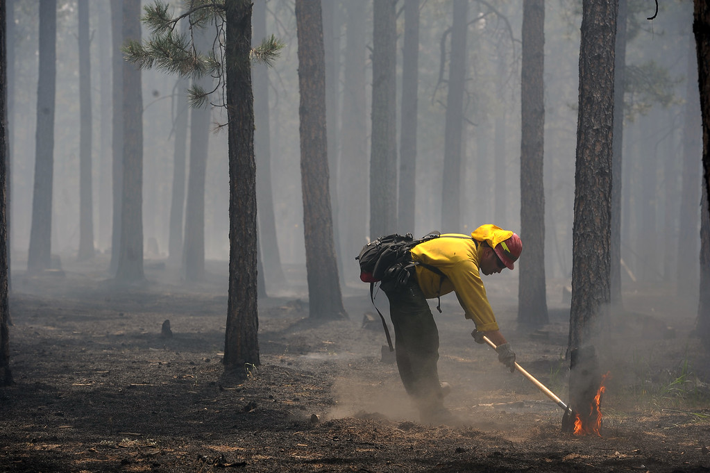 . Specialist Chris Butterfield, with the National Guard out of Fort Carson, help put out small fires in and around structures near Winchester Road north of  Hodgen Road in the midst of the Black Forest Fire on June 13, 2013.  Photo by Helen H. Richardson/The Denver Post)