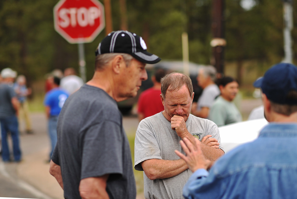 . Rich West, front center, and evacuees of Black Forest fire are waiting El Paso County Sheriff\'s escort to their property at the corner of Vollmer Rd. and Burgess Rd. Colorado Springs, Colorado. June 14, 2013.  (Photo By Hyoung Chang/The Denver Post)