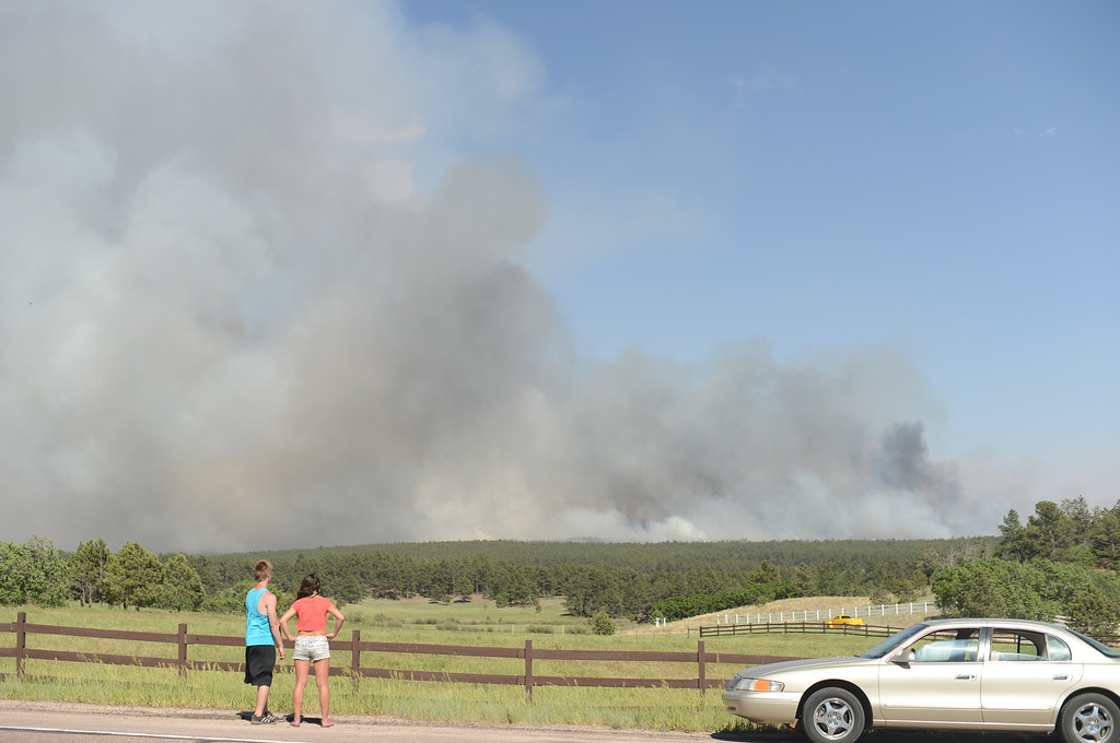. Colorado Springs, CO. - June 11: Annie Kostenbauer, 19, right, and Dustin Wilkins, 19, of Monument are watching the smoke covered Black Forest area. Colorado Springs, Colorado. June 11, 2013. The fire is about 15 acres near the 12600 block of Peregrine Way near Black Forest Regional Park. (Photo By Hyoung Chang/The Denver Post)
