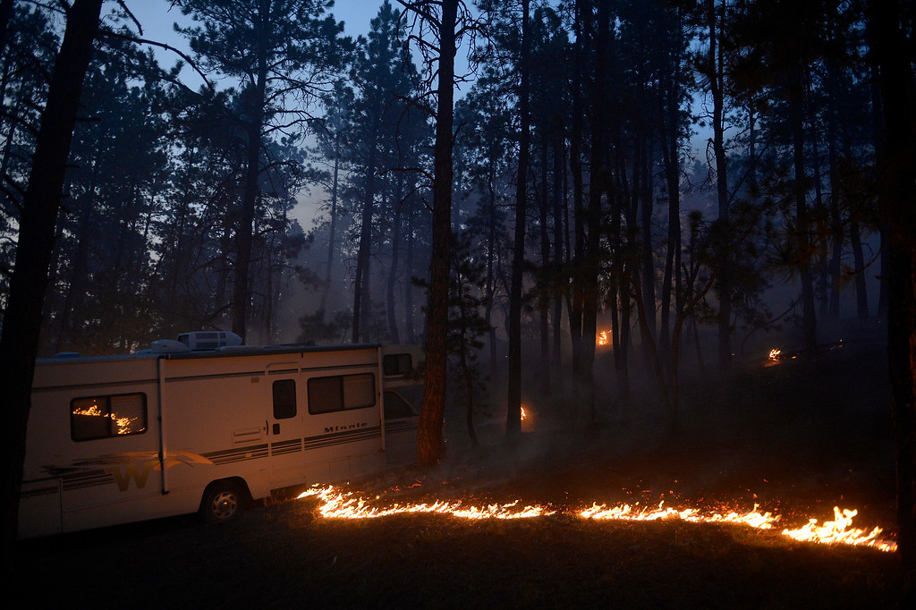 . COLORADO SPRINGS, CO - JUNE 11: Fire runs along the bed of the forest near a camper off of Herring Road in the Black Forest northeast of Colorado Springs, CO on June 11, 2013. Many homes have already been lost to the raging fire that continues to burn out of control. Photo by Helen H. Richardson/The Denver Post)