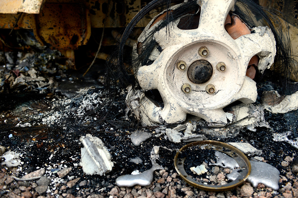 . COLORADO SPRINGS, CO - JUNE 18: The melted rim of a Ford T-Bird on a rental property owned by Jesse Russow, which was the southernmost home burned on the west side of Vollmer Road. The occupant of the home, who was not named, was only able to save himself and his motorcycle as he was away from the property when the evacuation took place. Russow is accepting donations for fire crews at 7195 Templeton Gap Road in Colorado Springs. (Photo by AAron Ontiveroz/The Denver Post)