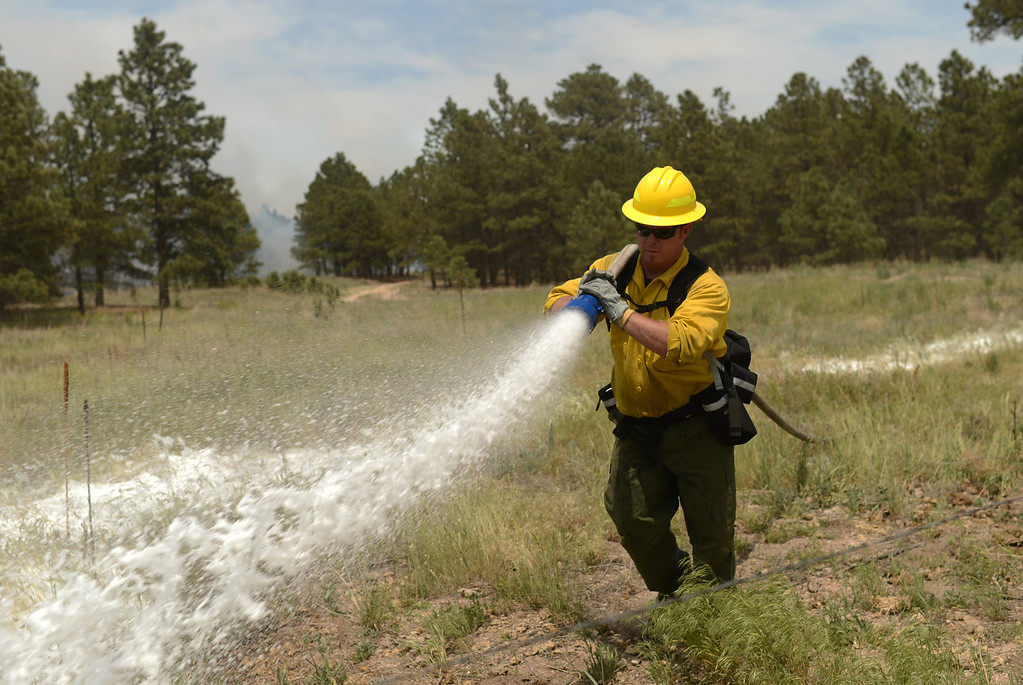. COLORADO SPRINGS, CO. - June 13: Dave Caulfield of Air Force Academy fire department is preparing for back burning at Black Forest section 16 trailhead. Colorado Springs, Colorado. June 13, 2013. The Black Forest fire has already destroyed at least 360 homes and consumed 15,000 acres. (Photo By Hyoung Chang/The Denver Post)
