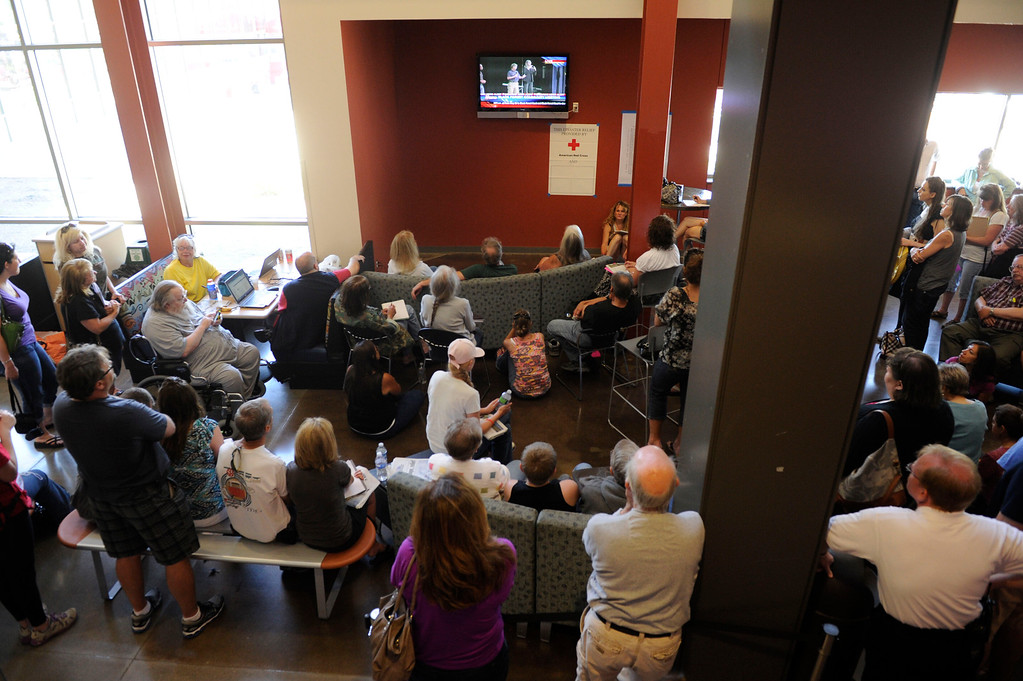 . An overflow crowd gathered to watch a television feed during a community meeting for Black Forest fire evacuees at Palmer Ridge High School Saturday morning, June 15, 2013. (Photo By Andy Cross/The Denver Post)