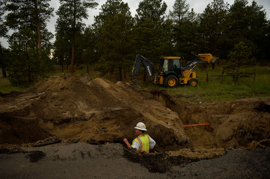 . COLORADO SPRINGS, CO. - June 14: Utility workers work to restore services to the the Black Forest Fire area near Colorado Springs, Colorado. June 14, 2013 Denver, Colorado Springs. (Photo By Joe Amon/The Denver Post)