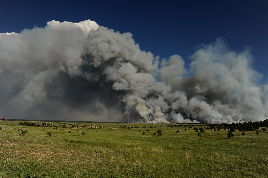 . COLORADO SPRINGS, CO - JUNE 11: A wall of dark smoke looms large over the horizon as fire destroys the landscape looking south from Mountain Dance Drive and Open Sky Way northeast of Colorado Srpings, CO on June 11, 2013. The Black Forest fire started around 1:45 in an area of the Black Forest northeast of Colorado Springs, CO. Homes have already burned and the wind is expected to continue through the afternoon. Photo by Helen H. Richardson/The Denver Post) 12