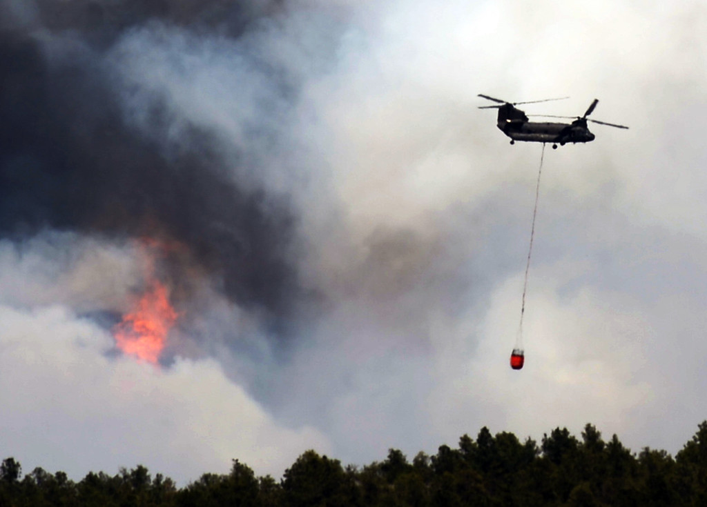 . COLORADO SPRINGS, CO. - June 12: A helicopter is heading to the fire site. Colorado Springs, Colorado. June 12, 2013. According to El Paso County Sheriff Terry Maketa, the Black Forest Fire north of Colorado Springs has already burned 80 to 100 homes. (Photo By Hyoung Chang/The Denver Post)