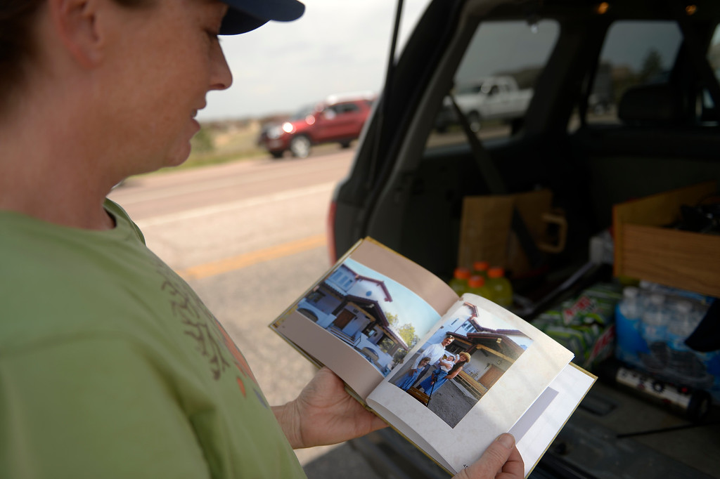 . COLORADO SPRINGS, CO. - June 14: Deanna Martin looks at a small photo book she grabbed on her way out of her home after getting medications and the families account info and passwords and videos of her 2 children\'s childhood in the home she and her husband Troy built as some residents were allowed back into the Black Forest Fire area to quickly get medications and important items that were left behind in the rush to evacuate near Colorado Springs, Colorado. June 14, 2013 Denver, Colorado Springs. (Photo By Joe Amon/The Denver Post)
