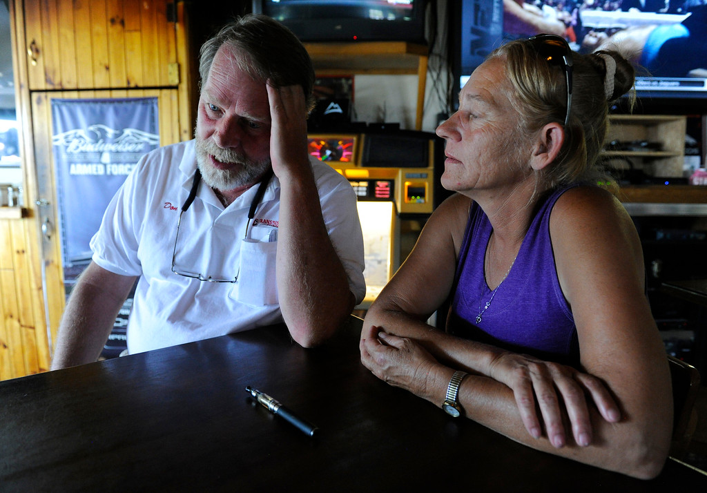 . Black Forest Fire evacuee, Don Callender, left, and his girlfriend, Judy McDowell, reflect on the loss of their home due to the fire from O\'Malley\'s Steak Pub in Palmer Colorado Saturday, June 15, 2013. Earlier, both attended a community meeting at Palmer Ridge high School to gather more information as to when they can go and see their home, a rental, but was destroyed. (Photo By Andy Cross/The Denver Post)