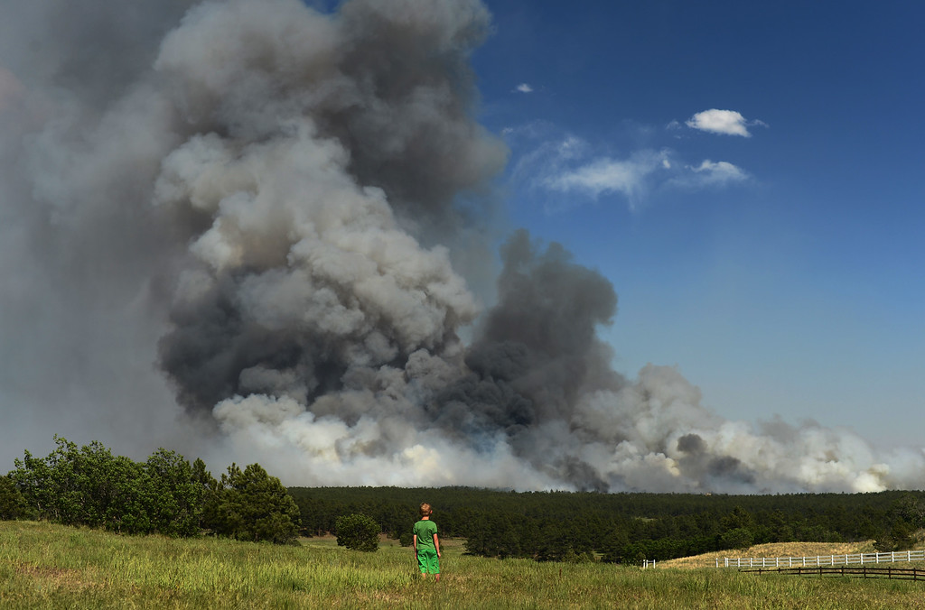 . Colorado Springs, CO. - June 11: Floyd Kerr Jr., 7, of Colorado Springs is watching the smoke cover BLack Forest area. Colorado Springs, Colorado. June 11, 2013. The fire is about 15 acres near the 12600 block of Peregrine Way near Black Forest Regional Park. (Photo By Hyoung Chang/The Denver Post)