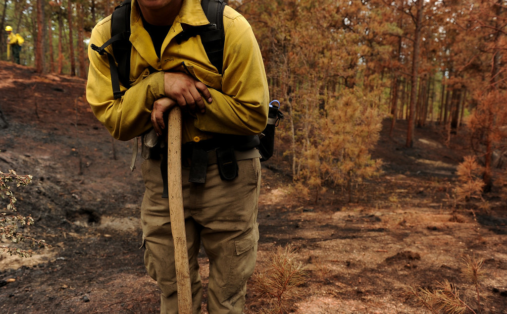 . BLACK FOREST, CO - JUNE 17:   James Gonzales, with Wildfire Support Team from Santa Fe, New Mexico looks for any kind of hotspots on properties inside of the Black Fire fire zone in Black Forest, CO on June 17, 2013.  The fire is now 75% contained and recent rains are helping firefighters. Photo by Helen H. Richardson/The Denver Post)