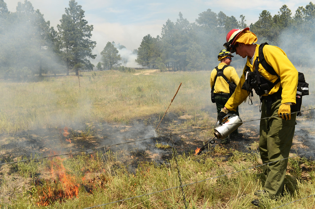 . COLORADO SPRINGS, CO. - June 13: William Gates of Air Force Academy fire department, front, is back burning at Black Forest section 16 trailhead. Colorado Springs, Colorado. June 13, 2013. The Black Forest fire has already destroyed at least 360 homes and consumed 15,000 acres. (Photo By Hyoung Chang/The Denver Post)
