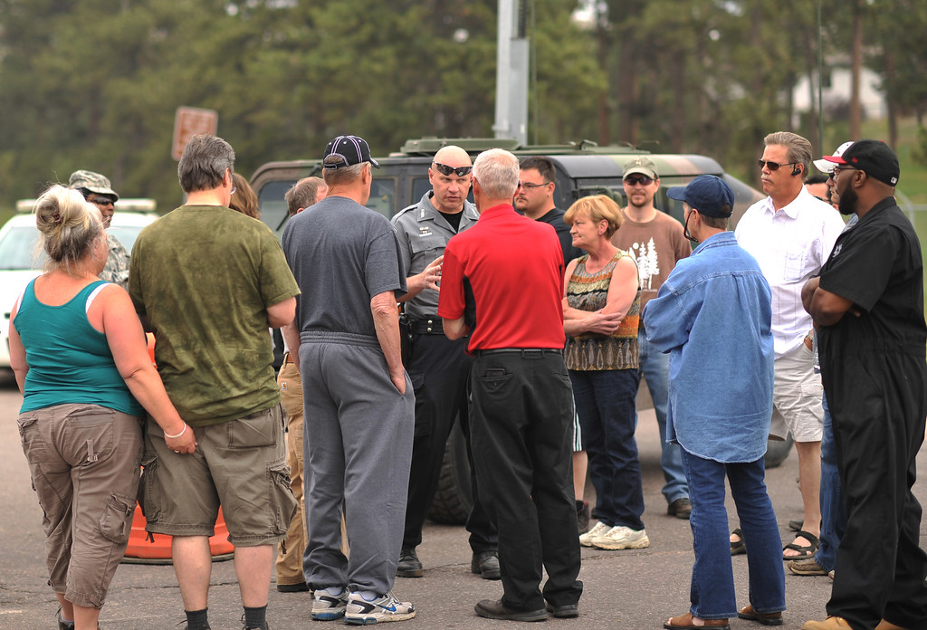 . COLORADO SPRINGS, CO. - June 14: Evacuees ask escort to their property to the El Paso County Sheriff at the corner of Vollmer Rd. and Burgess Rd., Friday June 14, 2013.  (Photo By Hyoung Chang/The Denver Post)