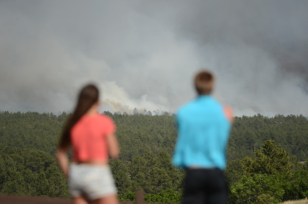 . Colorado Springs, CO. - June 11: Annie Kostenbauer, 19, left, and Dustin Wilkins, 19, of Monument are watching the smoke covered Black Forest area. Colorado Springs, Colorado. June 11, 2013. The fire is about 15 acres near the 12600 block of Peregrine Way near Black Forest Regional Park. (Photo By Hyoung Chang/The Denver Post)
