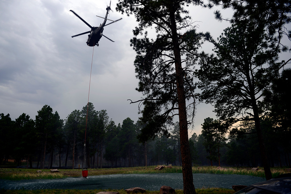 . COLORADO SPRINGS, CO - JUNE 13: A helicopter prepares to fill to fight the Black Forest fire burns east of Colorado Springs. (Photo by AAron Ontiveroz/The Denver Post)