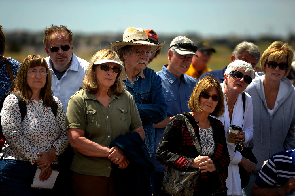 . COLORADO SPRINGS, CO. - June 17: John Adams (in cowboy hat) and his wife Gail (in green) strain to hear during the morning press conference as some residents were allowed back into the northern edge of the Black Forest Fire area near Colorado Springs, Colorado. June 17, 2013 Denver, Colorado Springs. (Photo By Joe Amon/The Denver Post)