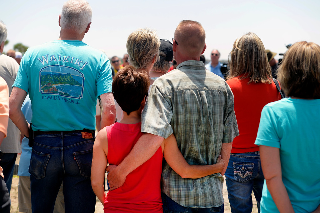 . Black Forest evacuees JP Derewicz, right, and his wife Tracy, left, listen closely to the  press briefing about the Black Forest Fire held for members of the media and for homeowners at Pikes Peak Community College Rampart Range Campus near Monument, CO  on June 15, 2013.  The two, who are living with friends in Monument while evacuated, have not lost their home.  Photo by Helen H. Richardson/The Denver Post)