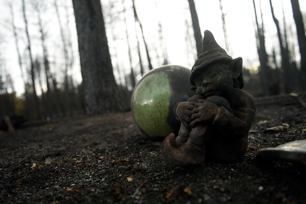 . COLORADO SPRINGS, CO. - June 18: The charred remains of a garden gnome in the rubble of Ted and Teresa Robertson\'s home that was totally taken by the fire as some residents were allowed back to see their homes in the Black Forest Fire area near Colorado Springs, Colorado. June 18, 2013. Colorado Springs. (Photo By Joe Amon/The Denver Post)