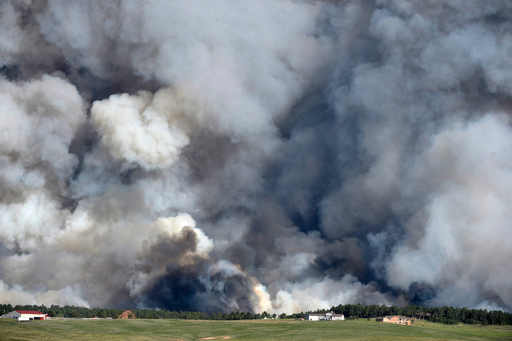 . COLORADO SPRINGS, CO - JUNE 11: A wall of dark smoke looms large over the horizon as fire destroys the landscape looking south from Mountain Dance Drive and Open Sky Way northeast of Colorado Srpings, CO on June 11, 2013. The Black Forest fire started around 1:45 in an area of the Black Forest northeast of Colorado Springs, CO. Homes have already burned and the wind is expected to continue through the afternoon. Photo by Helen H. Richardson/The Denver Post)