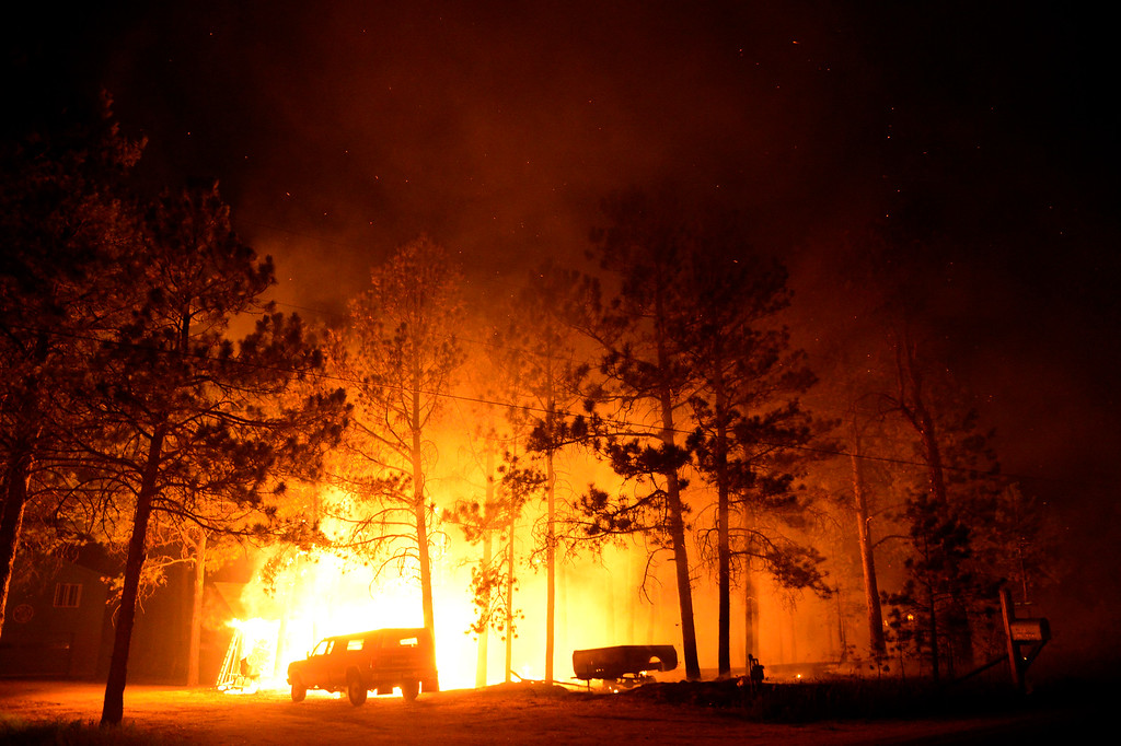 . COLORADO SPRINGS, CO - JUNE 11: A home near Herring and Swan is engulfed in flames as the Black Forest fire burns east of Colorado Springs. (Photo by AAron Ontiveroz/The Denver Post)