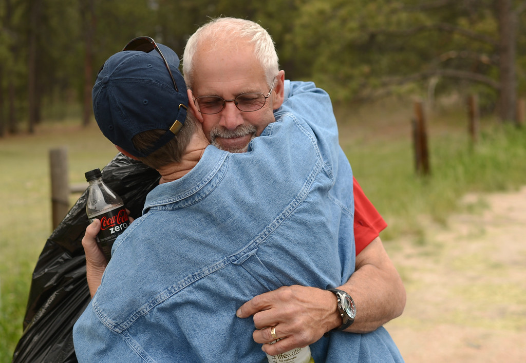 . COLORADO SPRINGS, CO. - June 14: Evacuees Gart Schinderlye, right, hugs Cindy Miller. Schinderlye find out his house was survived after the trip to his property by El Paso County Sheriff\'s escort. Colorado Springs, Colorado. June 14, 2013. Firefighters continue to battle the Black Forest fire north of Colorado Springs that has consumed 15,700 acres and 379 homes. (Photo By Hyoung Chang/The Denver Post)